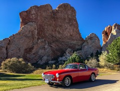 Red car by red rocks